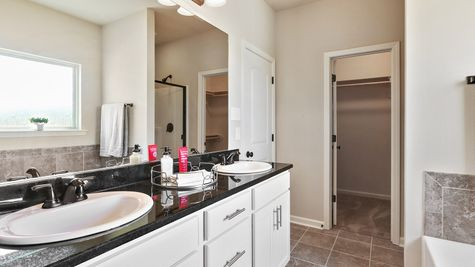 Natural Light- cream- white cabinets- dark granite- Master Bathroom- Open Floor Plan- Model Home- Silver Hill- Community- Ponchatoula Louisiana- Hammond area- DSLD Homes