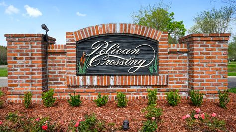 Front Entrance Sign with Flowers - New Home Construction - DSLD Homes Pelican Crossing Gonzales