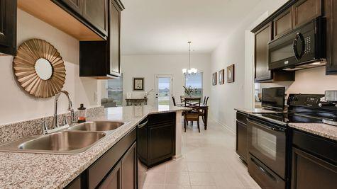 Kitchen with Dark Brown Cabinets  - Summerview - DSLD Homes Lafayette