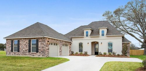 The Estates at Moss Bluff Model Home Exterior - Lafayette, LA - DSLD Homes