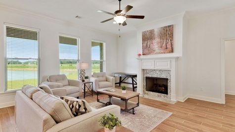 The Reserve at Conway Model Home Pictures- Large living room area with wood look floors