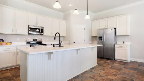 Kitchen with White Cabinets and Stainless Steel Appliances - Nature's Trail - DSLD Homes Biloxi