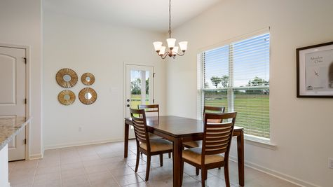 Dining Area- natural light- open floorplan- tile floor- Model Home - DSLD Homes- Baton Rouge area - St. Gabriel- Louisiana- Meadow Oaks