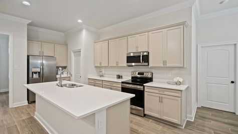 Kitchen with White Cabinets and Stainless Steel Appliances - Talla Pointe - DSLD Homes Ocean Springs