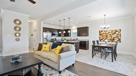 Living room, kitchen, and dining with decor - Hatten Farms - DSLD Homes Gulfport