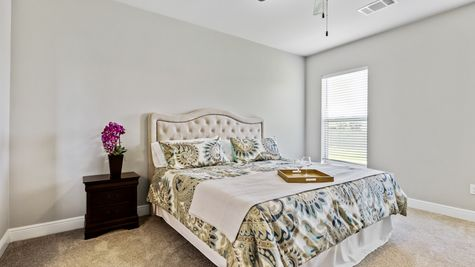 Master Bedroom with Decor - Orleans Run - DSLD Homes Lake Charles