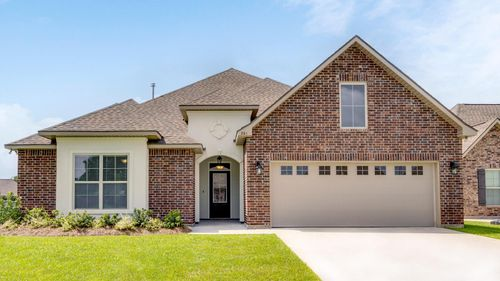 Front of Home- Brick- Stucco- arch- front loading garage- DSLD Homes- Lafayette area - Lafayette- Louisiana- The Estates at Moss Bluff
