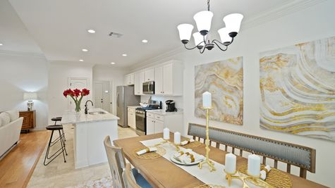 White Kitchen with Granite Counter tops and Stainless Steel Appliances - New Construction Homes - DSLD Homes Grand Oaks Gonzales
