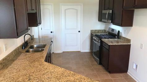 Brown Kitchen - Meadow Oaks Community - DSLD Homes St. Gabriel