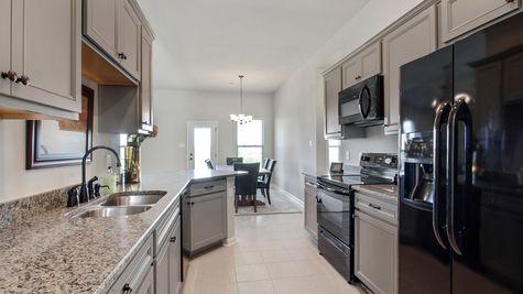 DSLD Homes - Liberty IV Open Floorplan Gray Kitchen Image