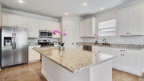 DSLD Homes - Camellia IV A Open Floor Plan - White Cabinets Kitchen Image
