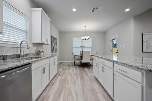 Simpson Farms Model Home Kitchen- Cary IV H Floor Plan - DSLD Homes - Covington, LA