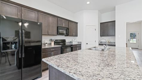 DSLD Homes - Troy III G Floorplan Kitchen Image - Belleview Quarters