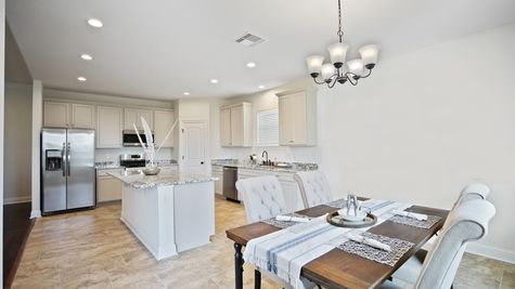 Large White Kitchen with Granite and Stainless Steel Appliances and Dining Room - New Home Construction - DSLD Homes Pelican Crossing Gonzales