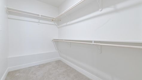 Model Home Master Bedroom Closet - DSLD Homes in Lake Charles - The Cove at Morganfield