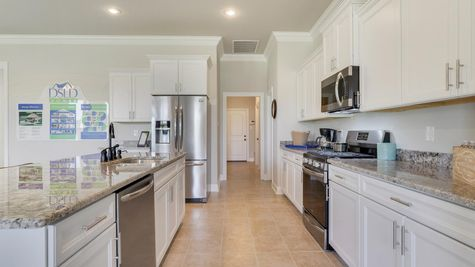White Kitchen Cabinets with Stainless Steel Appliances - Nickens Lake- DSLD Homes Denham Springs