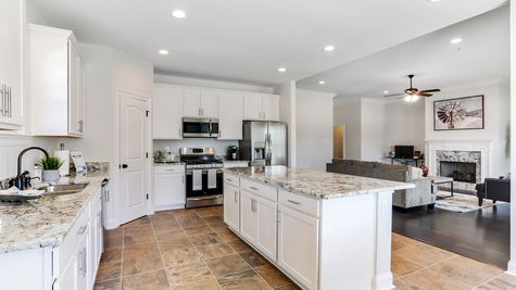 White Kitchen Cabinets from Stainless Steel Appliances - Ashton Parc - DSLD Homes Slidell