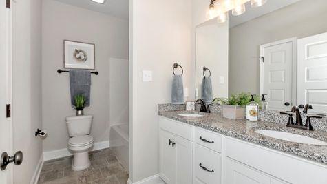 Ivanhoe II A Stone - Newby Chapel Community - DSLD Homes - Madison, AL - Model Home Hall Bathroom