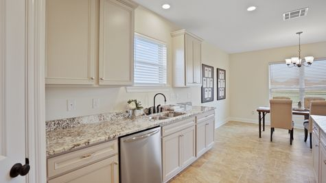 Large White Kitchen with Granite and Stainless Steel Appliances - New Home Construction - DSLD Homes Pelican Crossing Gonzales