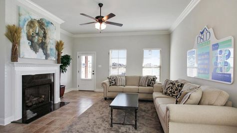Agreeable gray walls- white fireplace mantle- crown moulding- natural light- Living Room- Oak Grove- Model Home- Iowa Louisiana- Lake Charles area- DSLD Homes