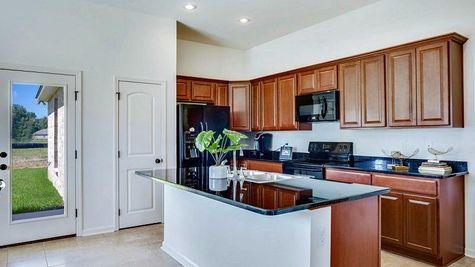 Re-dish Brown Kitchen Cabinets - RiverScape Village - DSLD Homes Shreveport