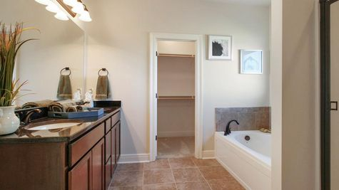 Agreeable gray walls- natural light- Dark wood cabinets- granite- garden tub- Master Bathroom- Oak Grove- Model Home- Iowa Louisiana- Lake Charles area- DSLD Homes