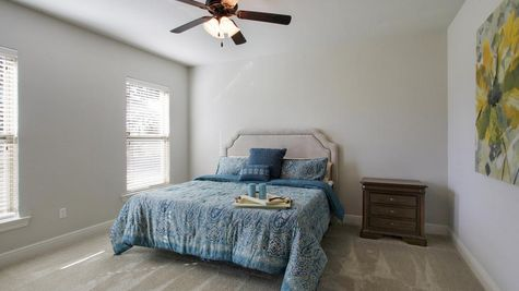 Agreeable gray walls- natural light- master bedroom- Oak Grove- Model Home- Iowa Louisiana- Lake Charles area- DSLD Homes