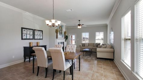 Agreeable gray walls- crown moulding- natural light- Dining Room- Oak Grove- Model Home- Iowa Louisiana- Lake Charles area- DSLD Homes