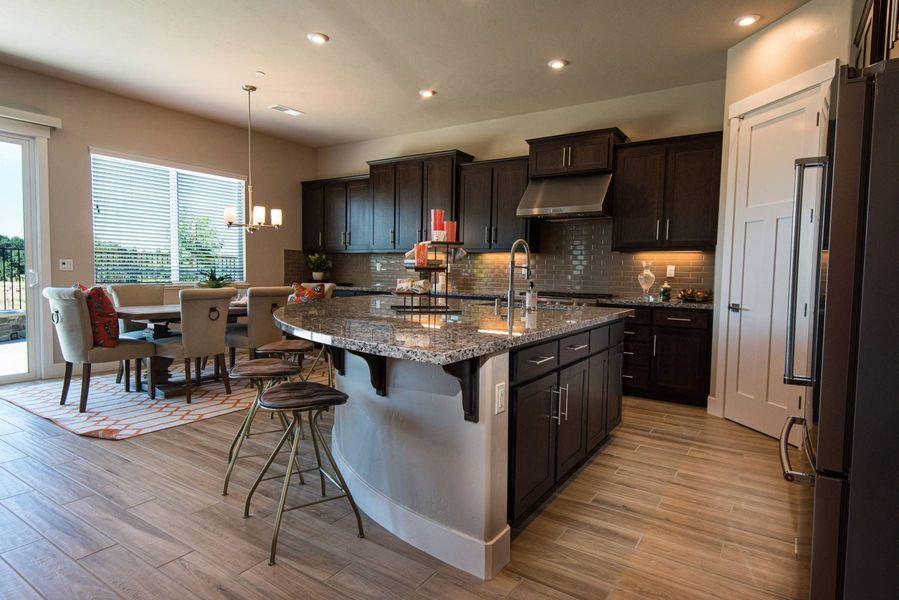 dark cabinet kitchen in a new home in roseville ca by elliott homes