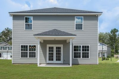 Rear Elevation - Customer enclosed included covered porch to create additional heated sqft and added covered patio