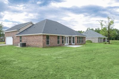 Rear view with sun room and bonus room - brick four sides per community and/or customer option selections