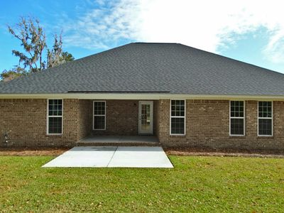 Rear view with included covered back porch - brick four sides per community and/or customer option selections