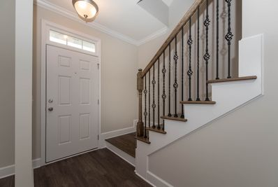 Shown with optional wood treads and iron balusters