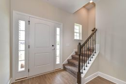 Foyer with carpet stairs and open oak handrail with iron balusters - *customer selections*