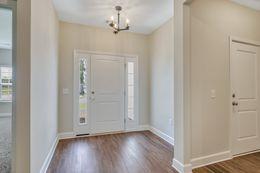 Foyer and door to right is garage door