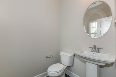 **Photo not of actual house**  Powder room