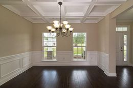 Dining Room with coffered ceiling and wainscoting