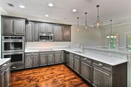 Kitchen - Optional Double oven option and wood floors and quartz countertops