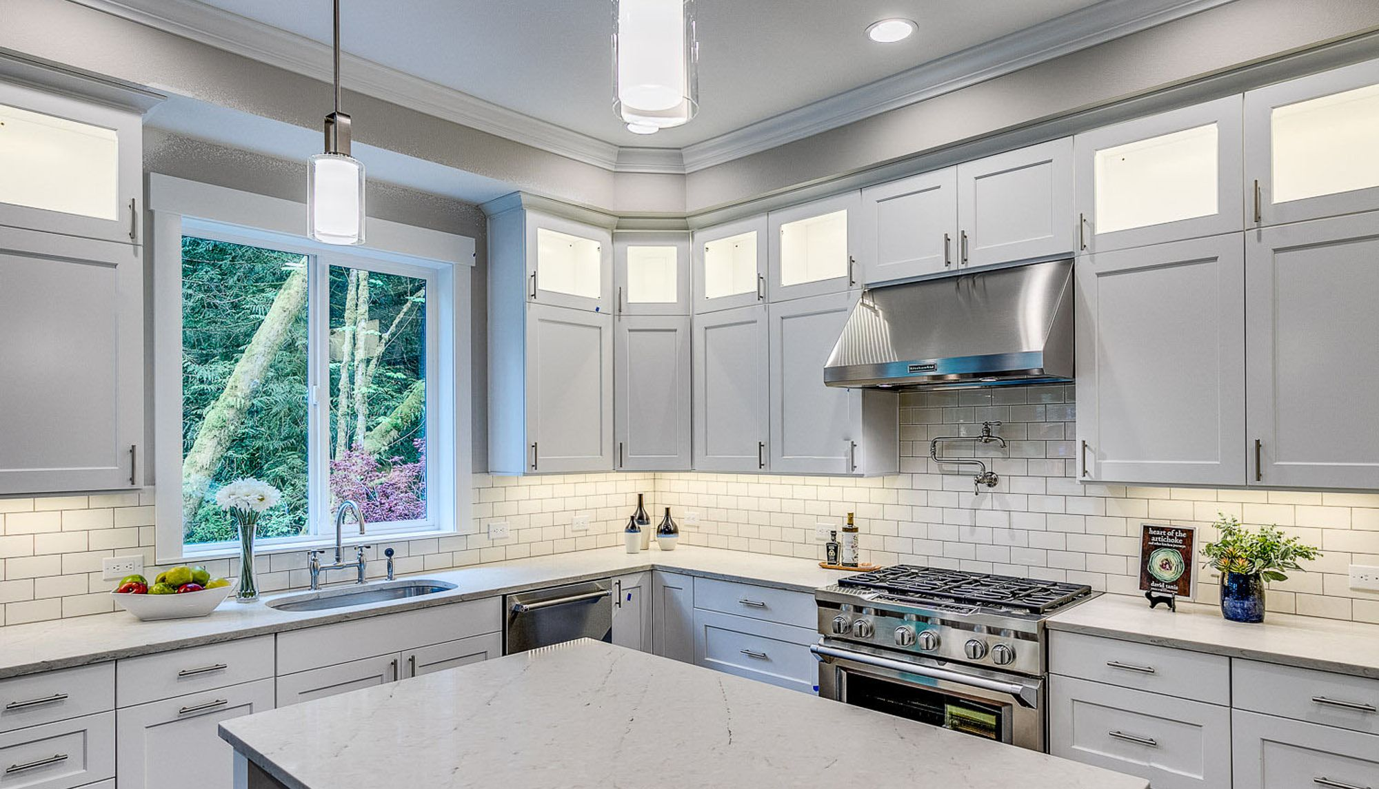 Harbor Custom Homes luxury kitchen with white cabinets and stainles appliances