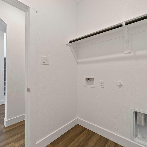 Landing at Providence model laundry room | HistoryMaker Homes