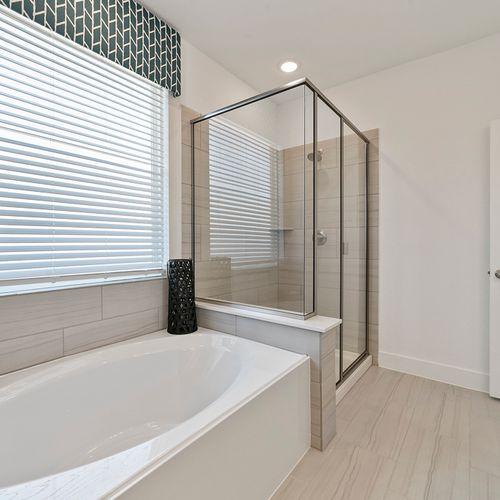 Landing at Providence model tub and shower | HistoryMaker Homes