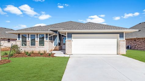 Homes by Taber Kamber B Elevation - 9125 NW 119th