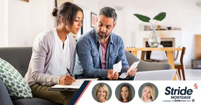A man and a woman looking over paperwork. Bottom right: Stride Mortgage logo.