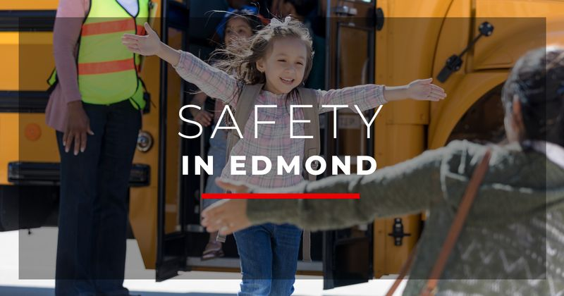 Child with safety officers in Edmond OK