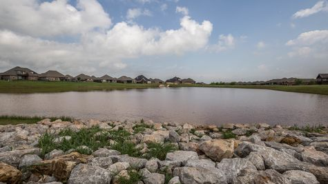 Limited pond homesites available in The Grove