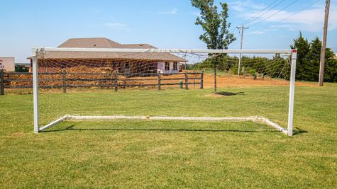 Homes by Taber Highland Village Soccer Field