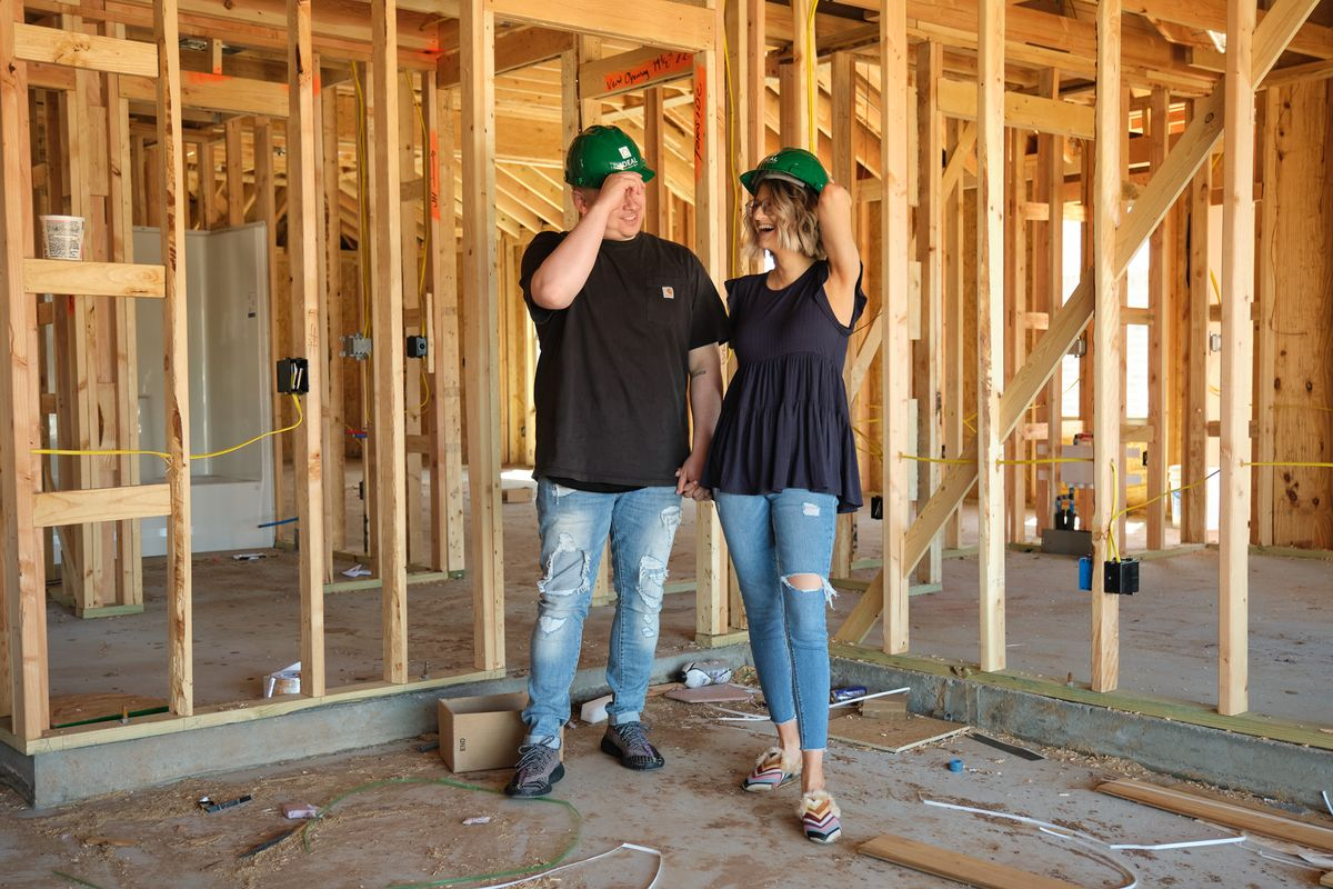 Homeowners inside home under construction