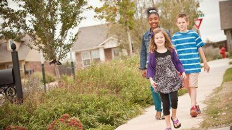 Family in Trail Woods, a community of Norman OK new homes from Ideal Homes