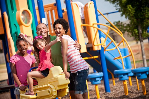 Family in a Somers Pointe park, an OKC new home community in the Moore and Yukon area from Ideal Homes