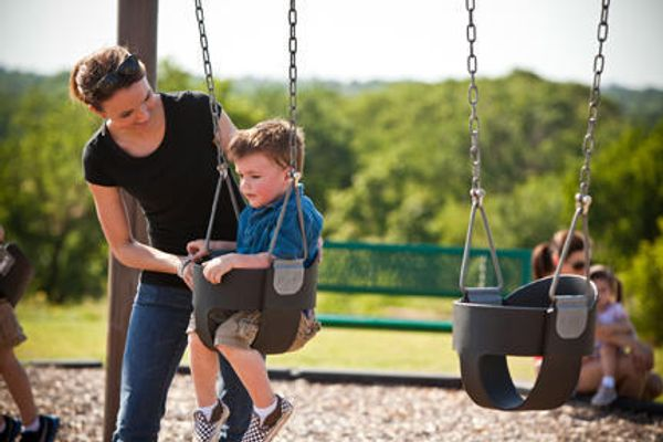 Families in a park at Red Canyon Ranch, a community of Norman OK new homes from Ideal Homes
